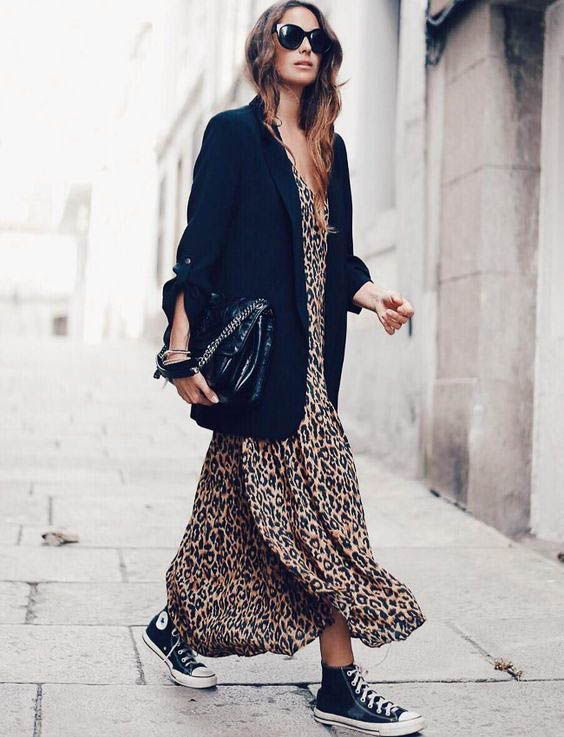 a leopard print midi dress, an oversized black blazer, black sneakers and a large black bag
