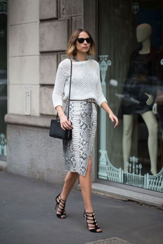a snake print midi skirt, a crochet white top, strappy heels and a black bag