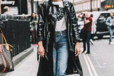 02 blue jeans, a printed tee, black platform shoes and a black leather trench