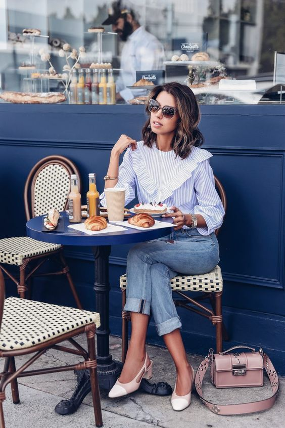 a blue thin stripe shirt with ruffles, blue cropped jeans, cremay and blush slingbacks and a blush bag