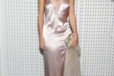 03 a blush silk slip maxi dress with a sheer cover in the neckline zone, a clutch and some faux fur by Rosie Huntington-Whiteley