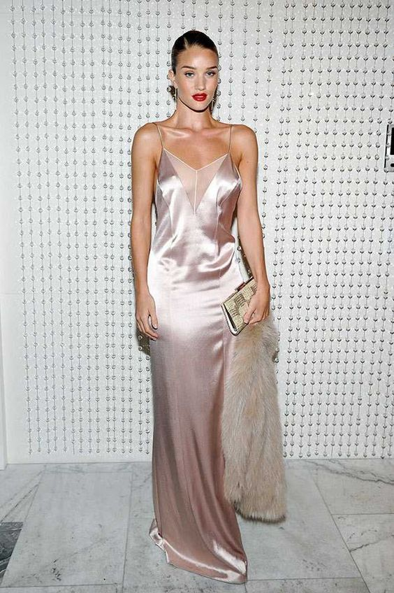 a blush silk slip maxi dress with a sheer cover in the neckline zone, a clutch and some faux fur by Rosie Huntington-Whiteley