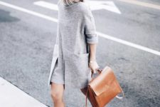03 a grey modern over the knee dress, black slipons, a black hat and an amber leather backpack