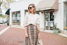 03 a neutral bag, a snake print midi skirt, a white top, brown boots to wear right now