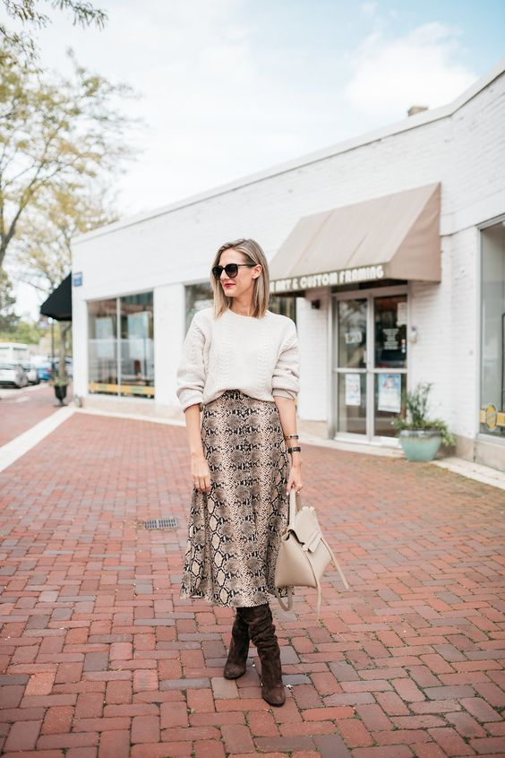 a neutral bag, a snake print midi skirt, a white top, brown boots to wear right now