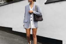 03 a white mini shirtdress, a grey oversized blazer, white trainers and a black bag
