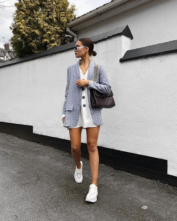 a white mini shirtdress, a grey oversized blazer, white trainers and a black bag