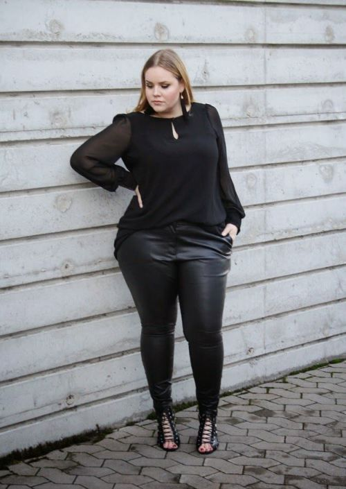 a black blouse with a drop cutout, black leather leggings, black lace up shoes for a party
