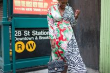 04 a bold wrap dress mixing a bright floral and zebra print, black strappy shoes and a black bag