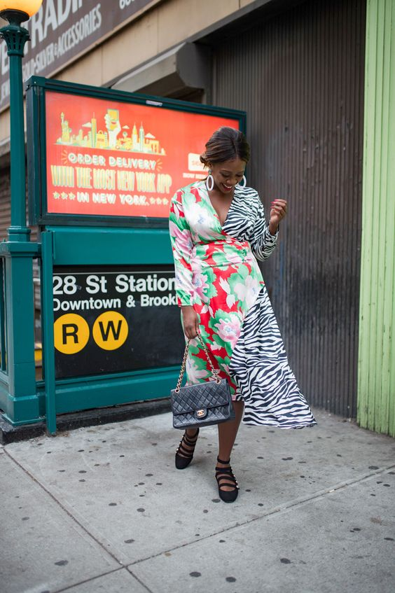 a bold wrap dress mixing a bright floral and zebra print, black strappy shoes and a black bag