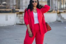 04 a bright red pantsuit, a white top, a necklace and bracelets plus nude heels