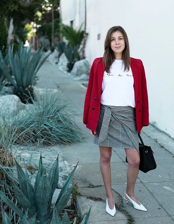 a draped mini, a printed tee, a red blazer, white heels and a black bag