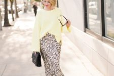 04 a snake print midi, a yellow top with bell sleeves, black sock boots and a black bag