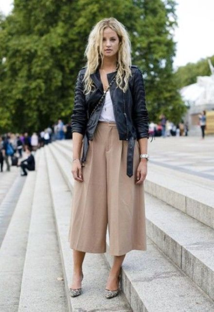 camel culottes, a white top, a black leather jacket and printed shoes plus a crossbody bag