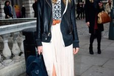 05 a black leather jacket, a printed tee, a neutral midi skirt with a front slit, black boots