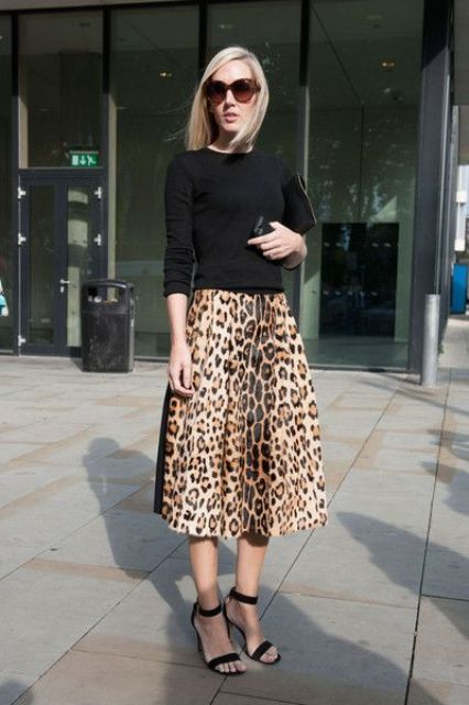 a black top, a leopard print midi, black shoes and a black bag for a trendy outfit