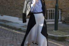 05 a geometric pleated midi, a blue shirt, black heels and a black leather jacket