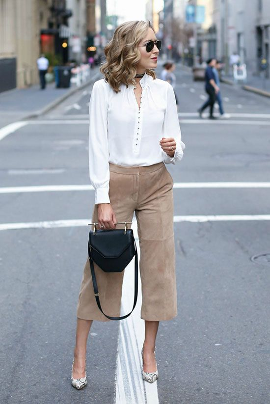 a white button down, camel suede culottes, a black bag and snake print shoes for work