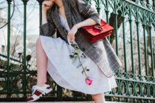 05 an airy white lace dress, an oversized checked blazer, red trainers and a red bag