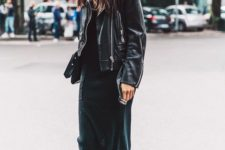 06 a black casual midi dress, an oversized black leather jacket and black sneakers plus a clutch