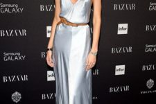 06 a silver slip maxi dress with a train, a statement necklace and earrings and a belt accent on the waist
