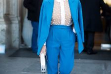 06 a sky blue pantsuit with cropped pants, a nude polka dot blouse with a white collar, creamy shoes and a white clutch