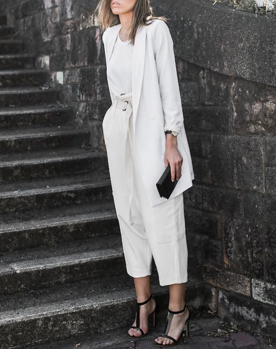 a white suit with culottes, a white tee, black ankle strap shoes and a black clutch for a party