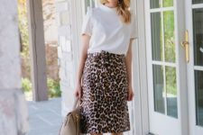 06 a white tee, a leopard print skirt, blush shoes and a neutral bag for spring