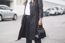 06 black denim, black sock boots, a white hoodie, a black leather trench and a black bag