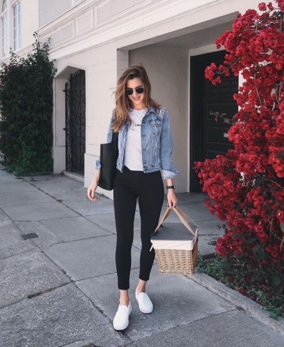 black jeans, a white tee, white sneakers and a blue denim jacket plus a black tote