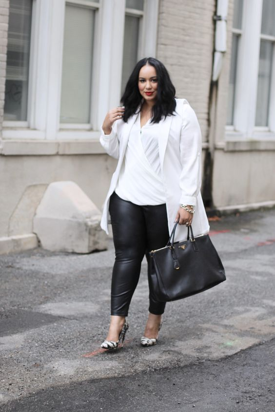 black leather leggings, a white draped top, a white long blazer, snake pring shoes and a black bag