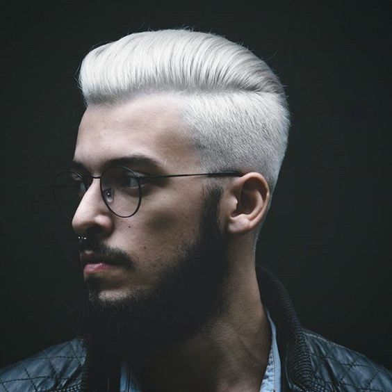 perfect silver blonde with a taper cut and short sides, a black beard and glasses
