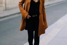 07 a black top, black skinnies, black booties and a rust-colored oversized blazer