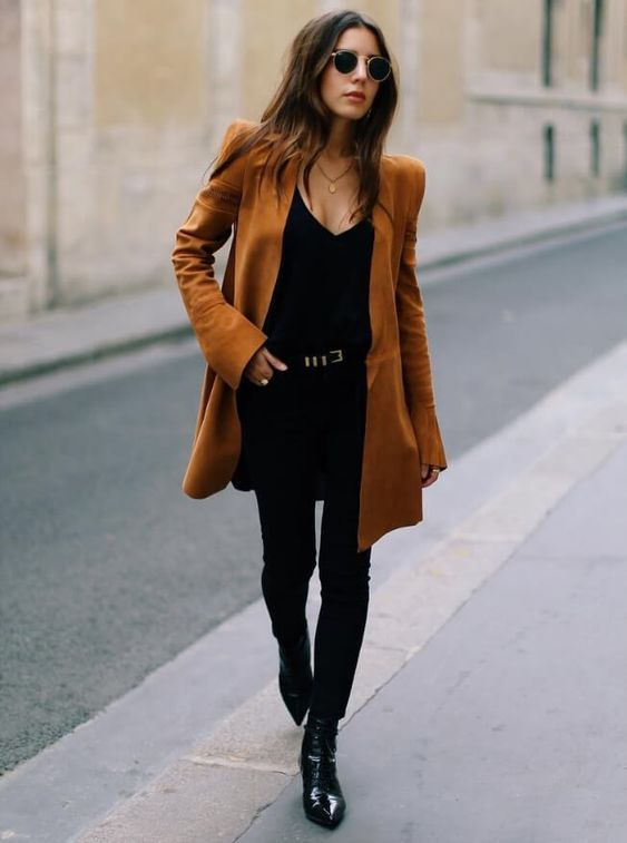 a black top, black skinnies, black booties and a rust colored oversized blazer