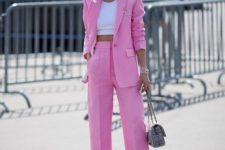07 a pink polka dot pantsuit, a white crop top, silver shoes and a printed bag