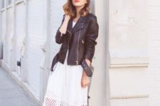 07 a retro-inspired lace midi dress, an oversized black leather jacket, black ankle strap shoes