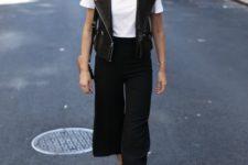 07  a white tee, black culottes, a black leather vest, leopard print shoes