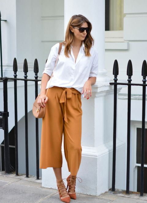 a wihte button down, camel culottes, a neutral bag and orange lace up shoes