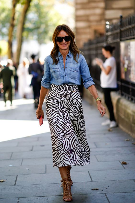a zebra print midi, a chambray shirt, brown strappy shoes for a spring boho look