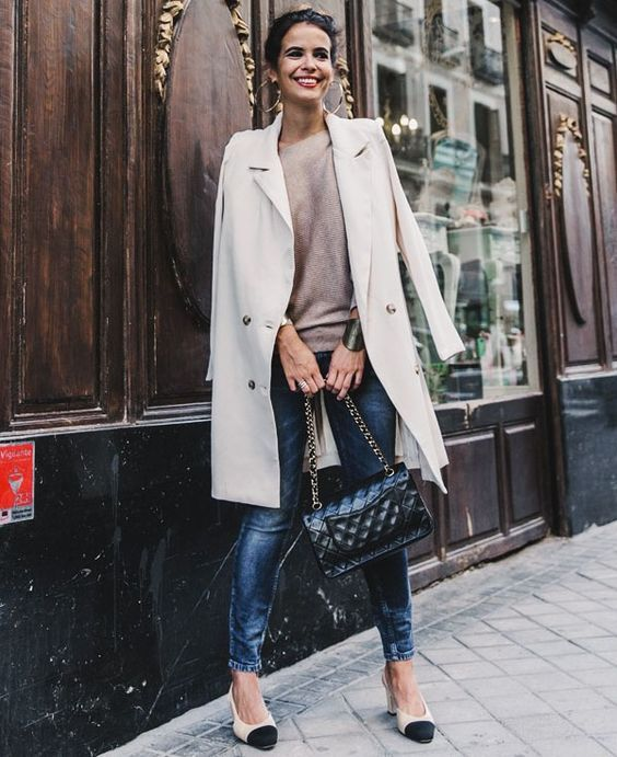 blue skinnies, a nude top, nude and blakc slingbacks, a creamy trench and a black bag