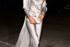 08 Chanel Iman wearing a silver slip maxi dress, a matching long cardigan and silver velvet shoes