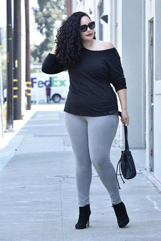 a black one shoulder top, grey leggings, black velvet boots and a black bag