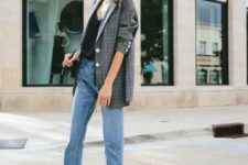 08 a black top, blue jeans with a raw hem, a plaid oversized blazer, black and creamy shoes