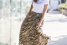 08 a graphic tee, a zebra print midi skirt, red shoes and a small bag