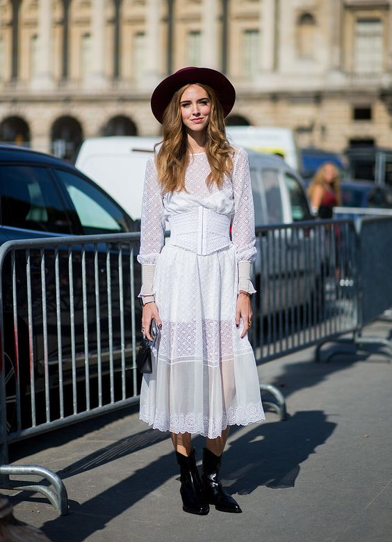 a white lace midi prairie dress, black boots, a burgundy har for a fashion statement