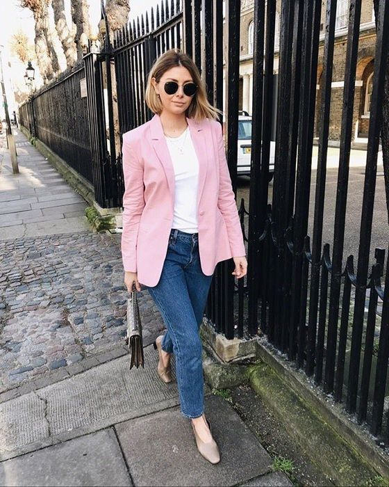 a white tee, blue jeans, nude shoes, a pink blazer and a small bag plus sunglasses