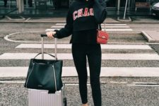 08 black skinnies, a black printed hoodie, a red crossbody and white sneakers for a sporty outfit