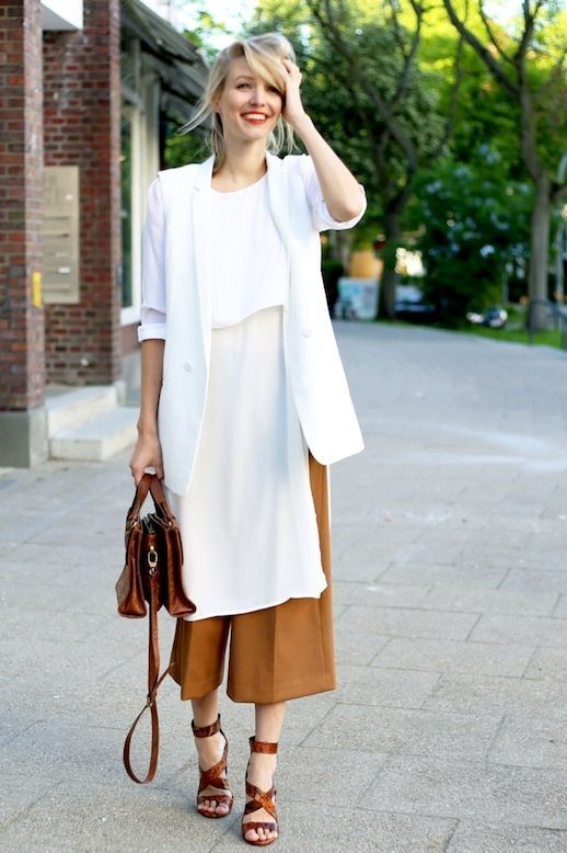camel culottes, a long white blouse, a white blazer, brown strappy heels and a brown bag for work