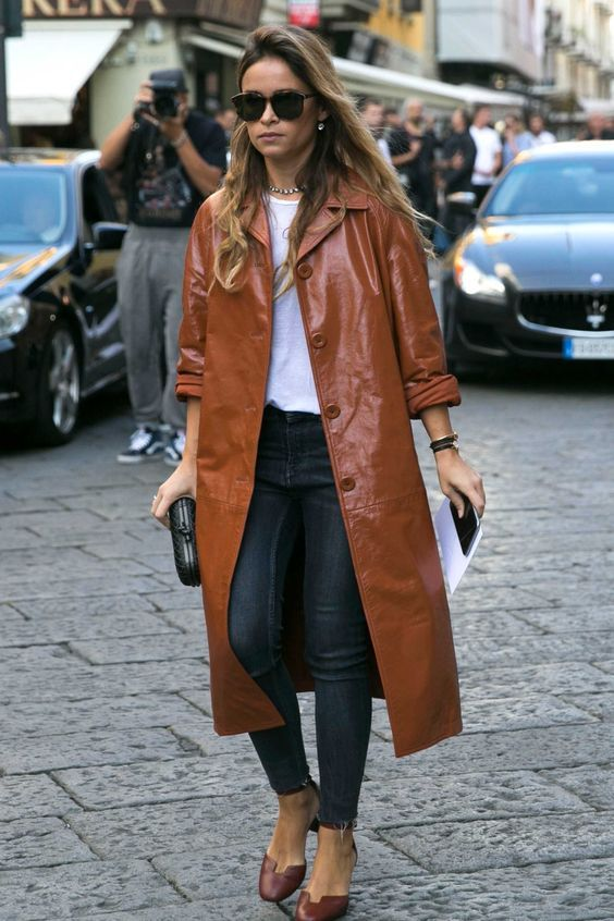 navy skinnies, a white tee, brown shoes and an amber leather trench