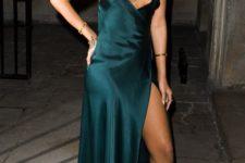 09 Rihanna wearing a dark green slip maxi dress with a thigh high slit, a statement necklace and metallic heels